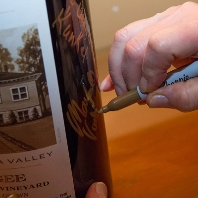 Wine Club members signing 3.0L bottle